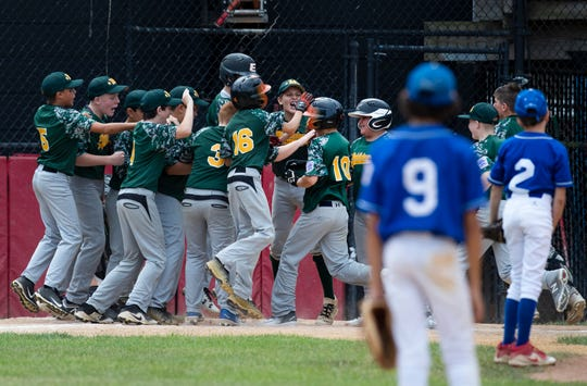 Middletown Little League's James Finer is mobbed at home plate after his 6th inning home run to win the Section 3 Little League Final.