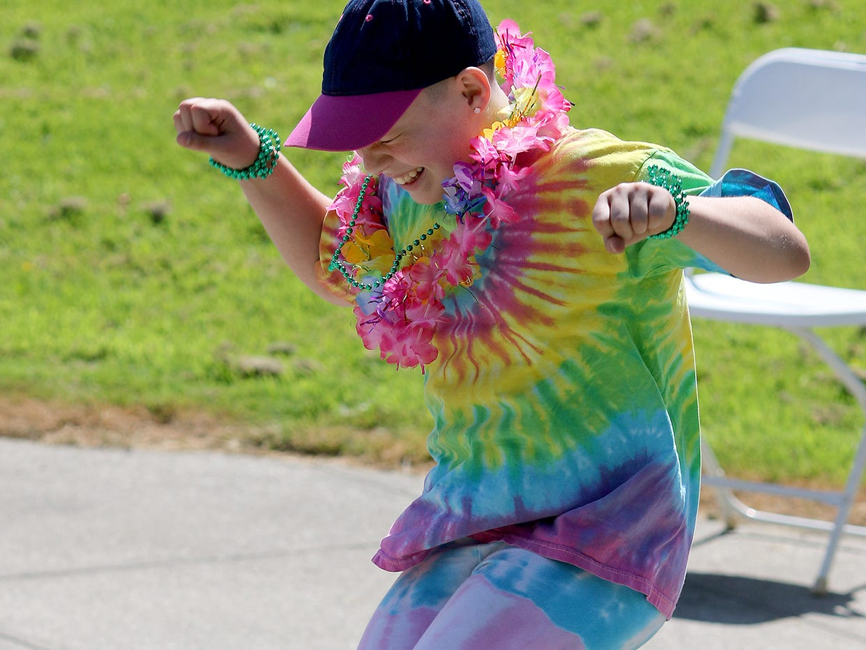 Airabella Rutledge, 10, of Bremerton, jumps to the music  at the Kitsap Pride Festival on Saturday July, 21, 2018 at Evergreen-Rotary Park in Bremerton.
