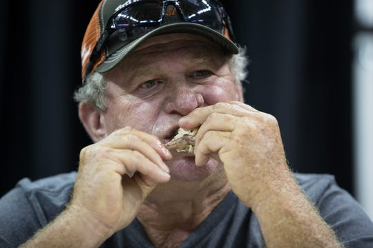 A contestant takes part in the the ghost pepper wing challenge during Wingapalooza at the American Bank Center on Saturday, July 21, 2018.