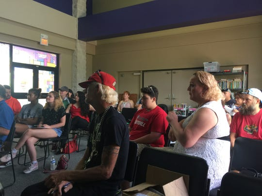 People listen during a town hall meeting  about the LGBT center and what services could be offered.