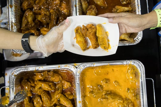 Googly's wings are served during Wingapalooza at the American Bank Center on Saturday, July 21, 2018.