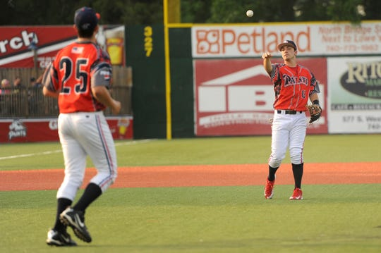 Chillicothe Paints infielder Chad Roberts throws the ball to pitcher Jake Shields during a game against Champion City at the VA Memorial Stadium in June of 2015.
