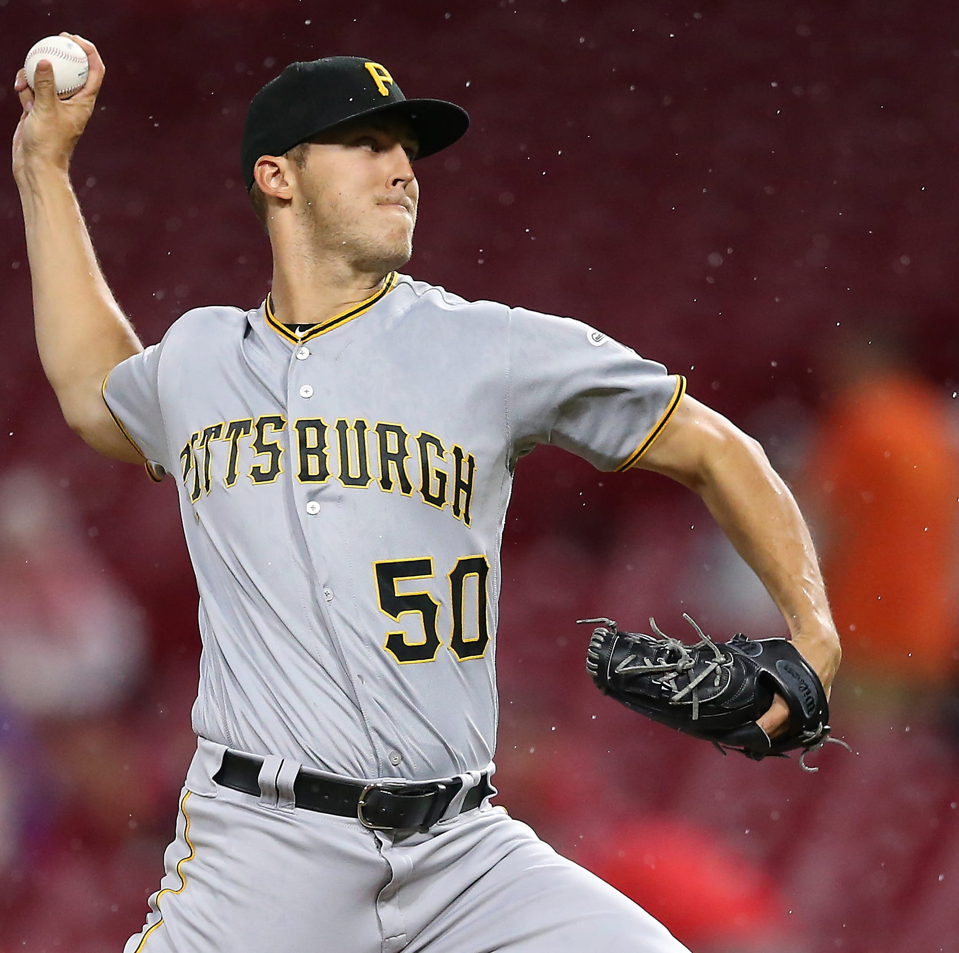Pittsburgh Pirates starting pitcher Jameson Taillon (50) delivers in the first inning during a National League baseball between the Pittsburgh Pirates and the Cincinnati Reds, Friday, July 20, 2018, at Great American Ball Park in Cincinnati.