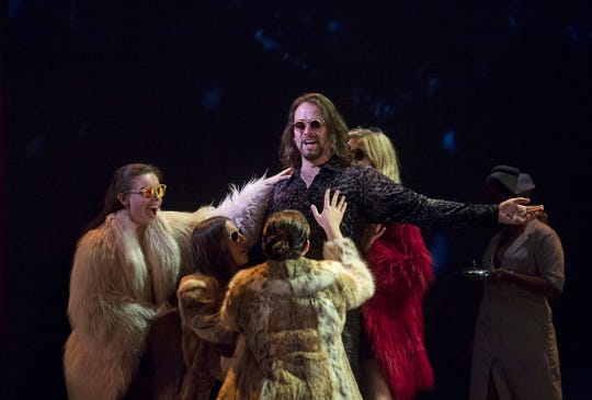 "In one of the many flashback scenes in ""Another Brick in the Wall,"" rock star Pink (Nathan Keoughan) recalls the attention lavished on him by the ever-present groupies. Cincinnati Opera is performing the U.S. premiere of Julien Bilodeau's opera at Music Hall through July 31."