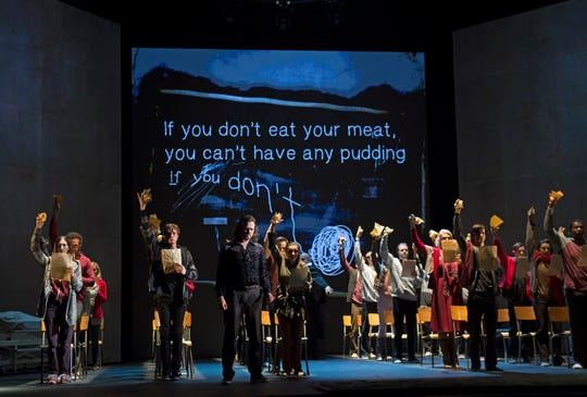"""Pink (Nathan Keoughan) remembers horrible school days in Cincinnati Opera's U.S. premiere production of Julien Bilodeau's """"Another Brick in the Wall."""" The opera, which premiered in 2017, is adapted from Pink Floyd's 1979 album, """"The Wall."""""""