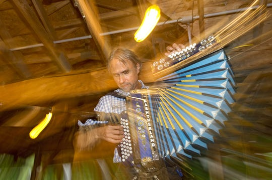 Rick Ipach plays accordian in the pavilion at Schutzenfest.