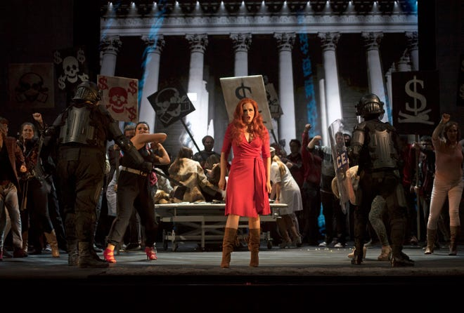 """Pink's Wife (Caroline Bleau) leads a raucous and impassioned protest against banks and big business in Cincinnati Opera's U.S. premiere of Julien Bilodeau's """"Another Brick in the Wall."""" The opera, based on Pink Floyd's 1979 album, runs at Music Hall through July 31."""