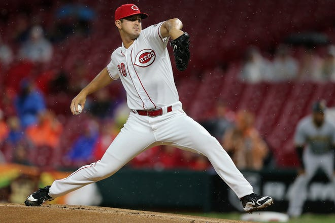 Cincinnati Reds starting pitcher Tyler Mahle (30) delivers in the first inning during a National League baseball between the Pittsburgh Pirates and the Cincinnati Reds, Friday, July 20, 2018, at Great American Ball Park in Cincinnati.
