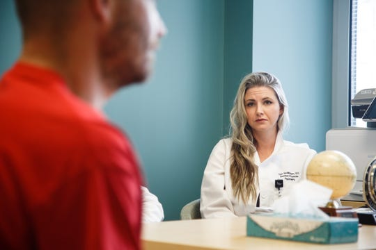 Mercy psychiatric resident Tyler VanMilligen, right, listens in a doctor talks with a patient on Thursday,  July 19, 2018, in Des Moines. Mercy and Broadlawns Hospitals are starting new psychiatric residency programs to train young doctors.