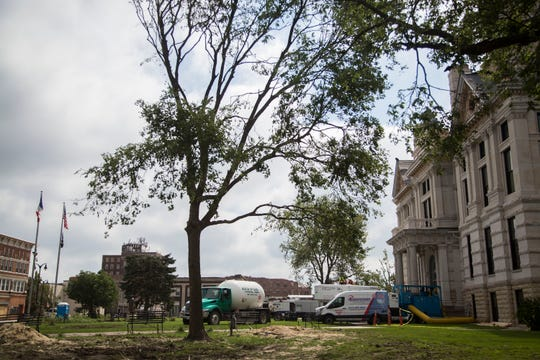 Perfection Property Restoration crews repair and dry out the damaged Marshall County Courthouse on Saturday, July 21, 2018, in downtown Marshalltown.