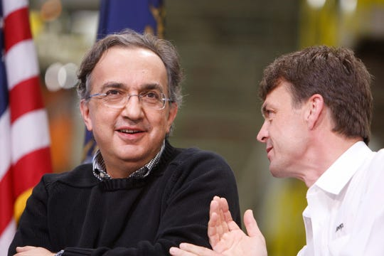 In this Friday, May 21, 2010 file photo, Chrylser CEO Sergio Marchionne, left, is seen with Jeep brand President and CEO Mike Manley at the Jefferson North Assembly Plant, in Detroit.