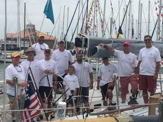 Chris Cyrul (far right) and his son Michael, middle, were part of the Blitzkrieg crew that won the Bayview Mackinac Race in their class, as well as first overall.