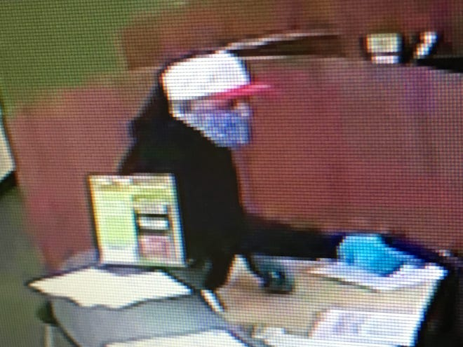 A photo of the suspect from Saturday's armed robbery at The Cash Store in Ashwaubenon.