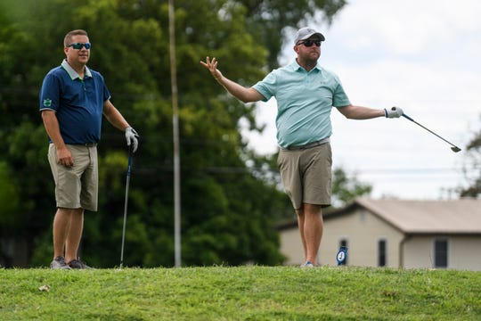 In this file photo from July 2018, Adam Davis, right, reacts unhappily to how he teed off on the second hole as Kyle Congon, left, watches where the ball lands during the first round of the Jace Bugg Men's City Golf Tournament at Henderson Municipal Golf Course. The last day of operation for the course is Sunday, July 7.