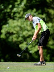 Parker Brown putts on the sixth hole green while competing in the first round of the Jace Bugg Men's City Golf Tournament at Henderson Municipal Golf Course in Henderson, Ky., Saturday, July 21, 2018.