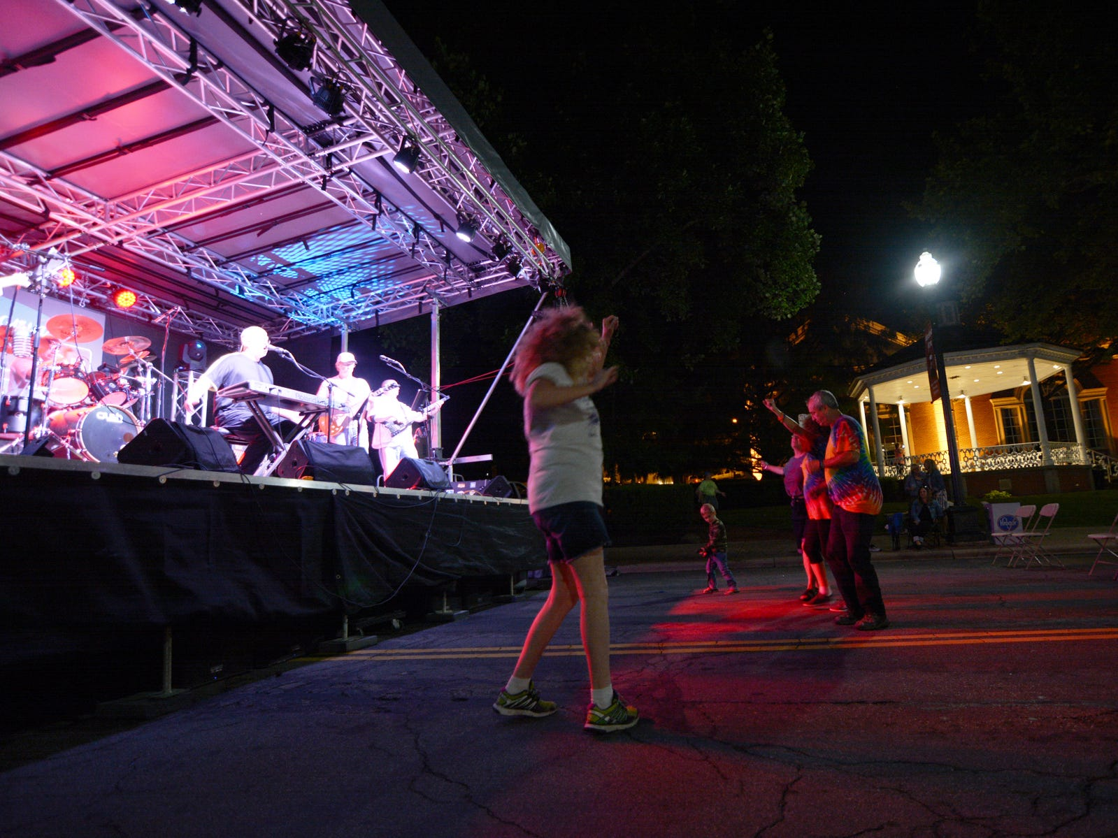 People dance around the Destination Downtown ArtWalk stage Friday night, July 20, 2018, in Lancaster.