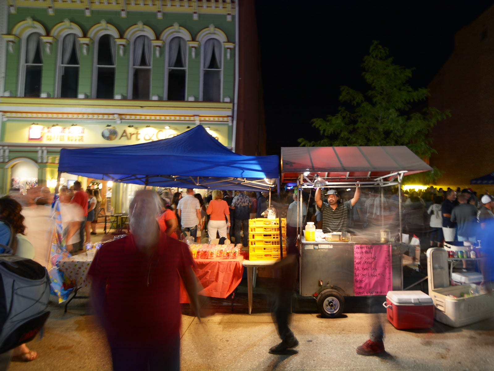Darrel DeBerry of D's Dogs food cart waits to sell the next order of food Friday evening, July 21, 2018, during the Lancaster Festival ArtWalk in Lancaster.