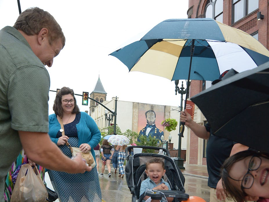 Harrison Uhl, 2, and Brinn Bradley, 6, enjoy the afternoon with family at the Lancaster Festival ArtWalk Friday, July 20, 2018.