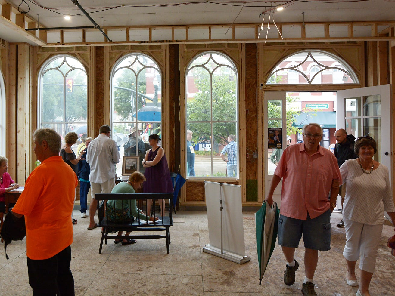 People look around the gallery inside of the Mithoff building in its unfinshed state Friday evening, July 20, 2018, during the Lancaster Festival ArtWalk.