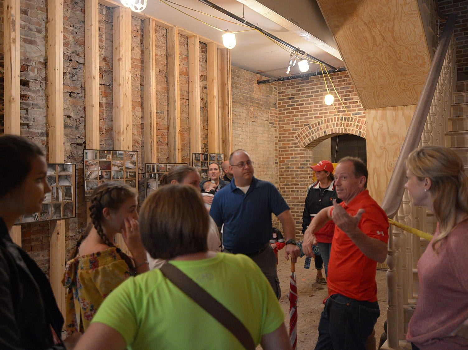 Brad Hutchinson talks about the process and progress of renovating the Mithoff building Friday evening, July 20, 2018, during the Lancaster Festival ArtWalk. Hutchinson owns the historical Lancaster structure.