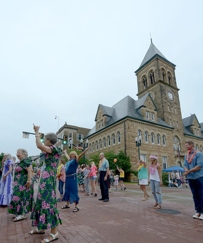 A luau flash mob appeared Friday evening, July 20, 2018, during Lancaster Festival ArtWalk.