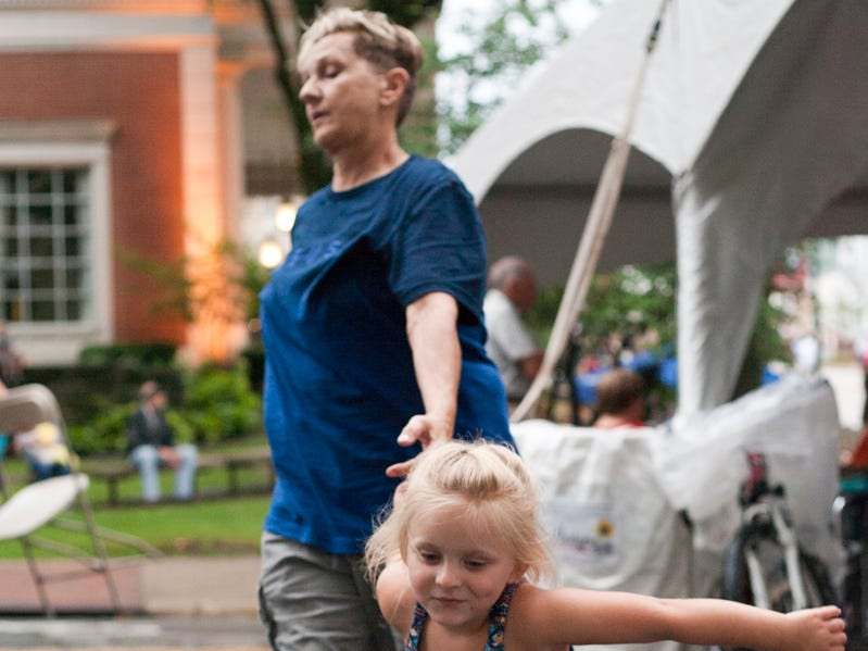 Serena Cramblit, 3, pulls great-great-aunt Bev Cook to dance Friday afternoon, July 20, 2018, during the annual Lancaster Festival ArtWalk.