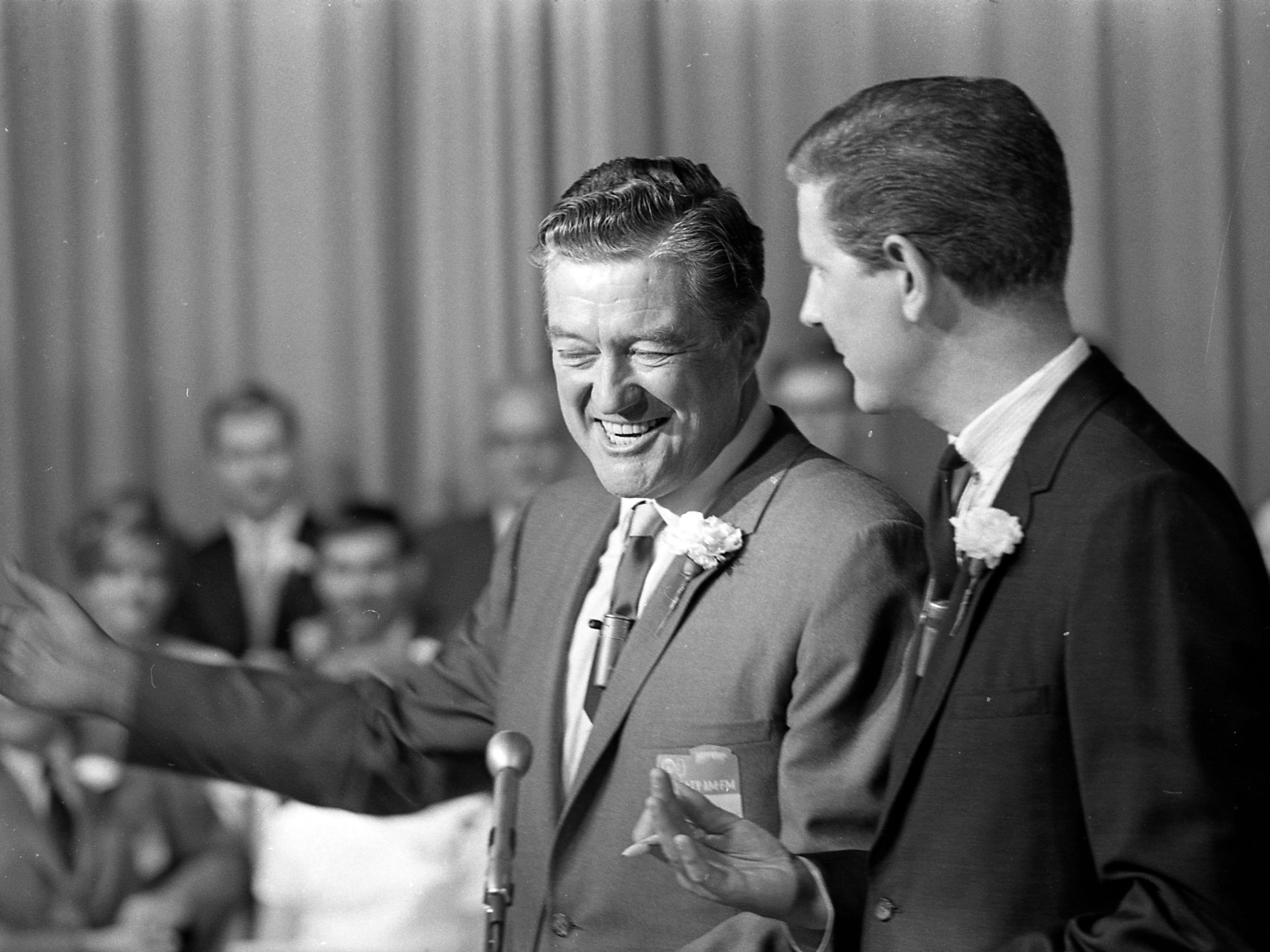 Veteran actor Dennis Morgan (left), a Wisconsin native who got his start singing at WTMJ radio, takes part in the station's 40th anniversary celebration in 1967. This photo was published in the Aug. 6, 1967, Milwaukee Journal, which owned WTMJ at the time.