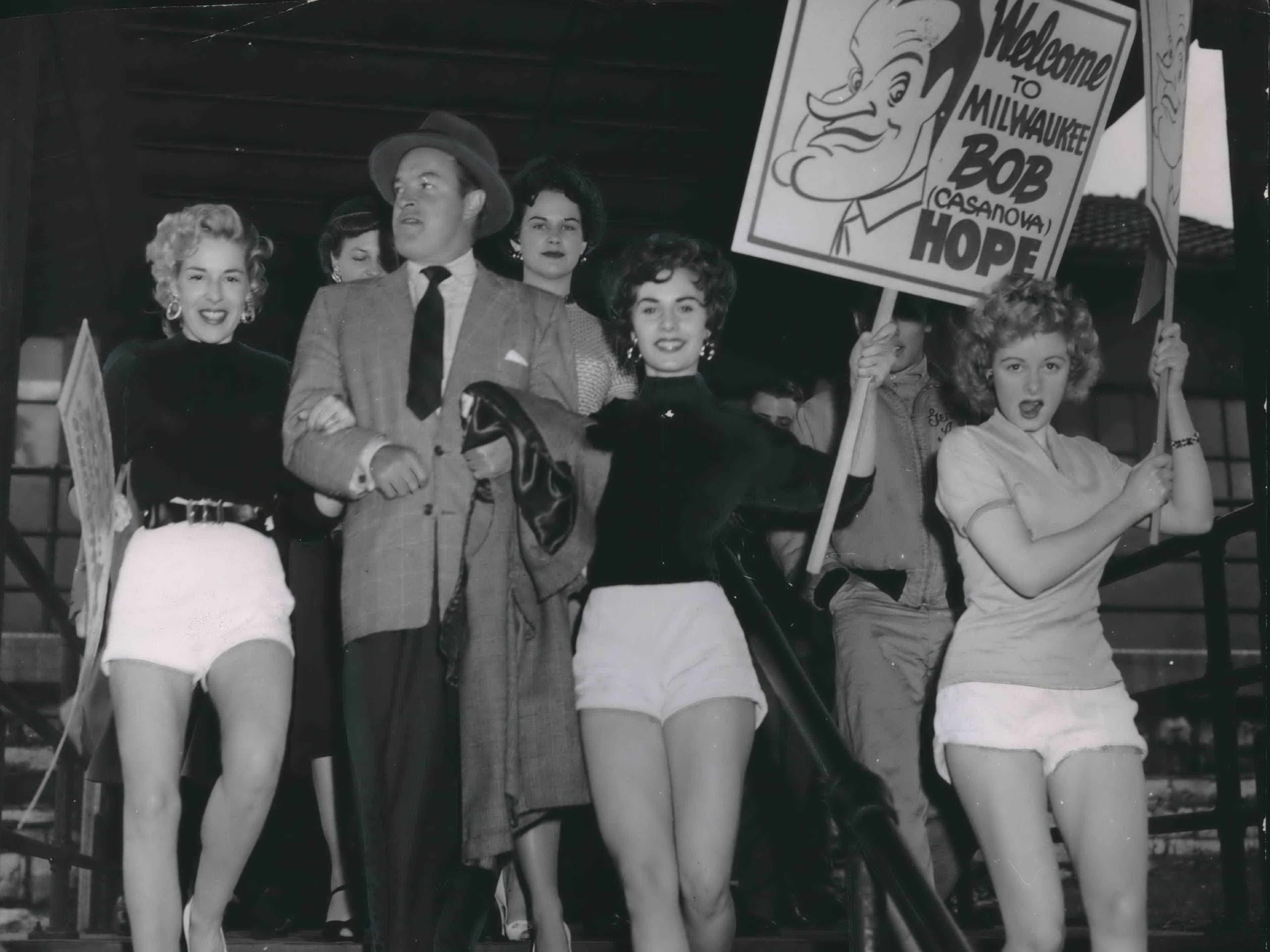 Bob Hope gets a big welcome when he arrives in Milwaukee by train at the Chicago and North Western road station on April 27, 1954. The comedian came to town for the annual cancer fund show at the Wisconsin Theater, where he shared the stage with stars Pat O'Brien, Cy Howard, Marie McDonald, and Elaine Carvel. This photo was published in the April 27, 1954, Milwaukee Journal Extra section.