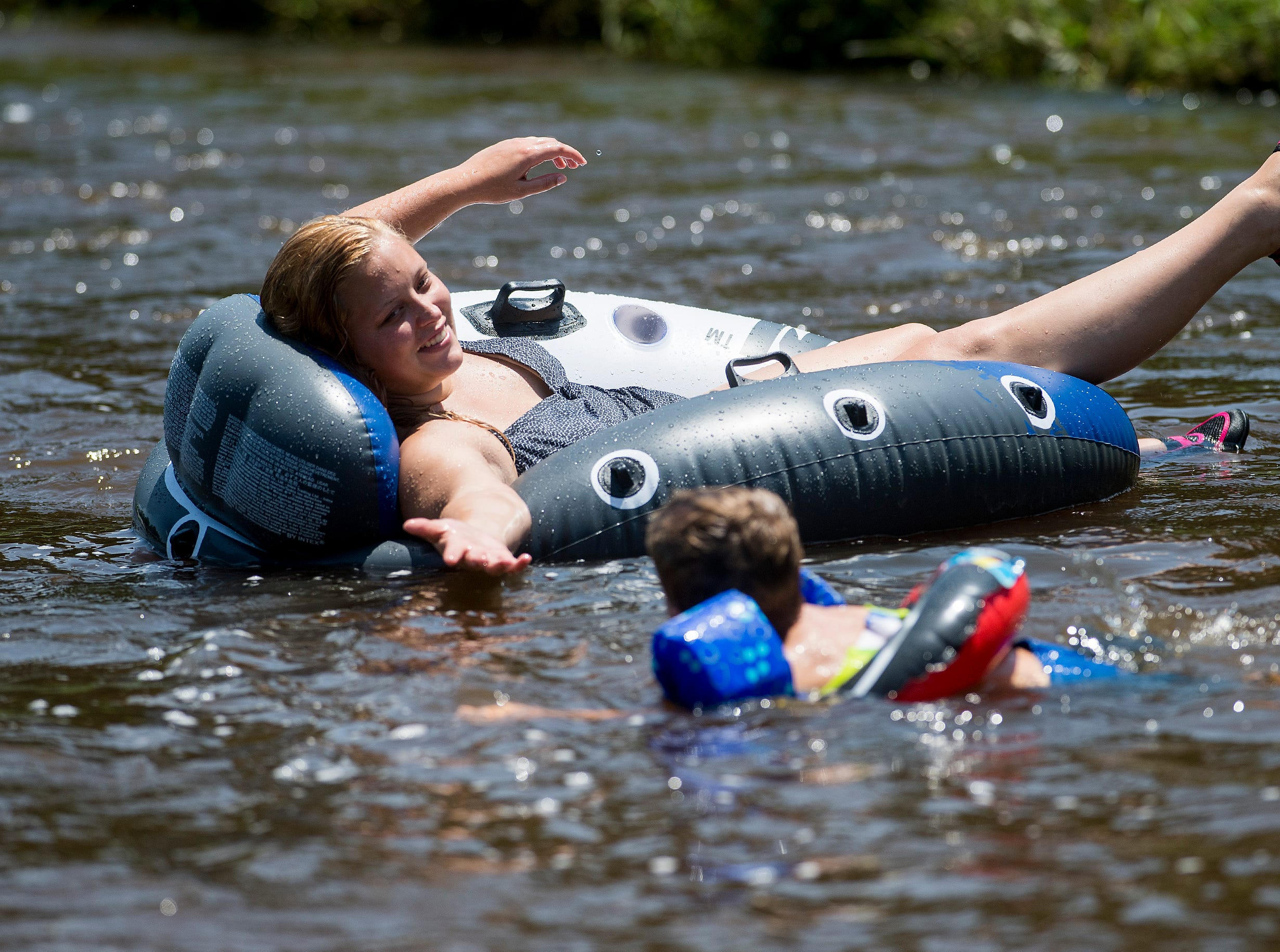 Karson Smith and Sawyers Sims float on Autauga Creek in Prattville, Ala., on Saturday, July 21, 2018.