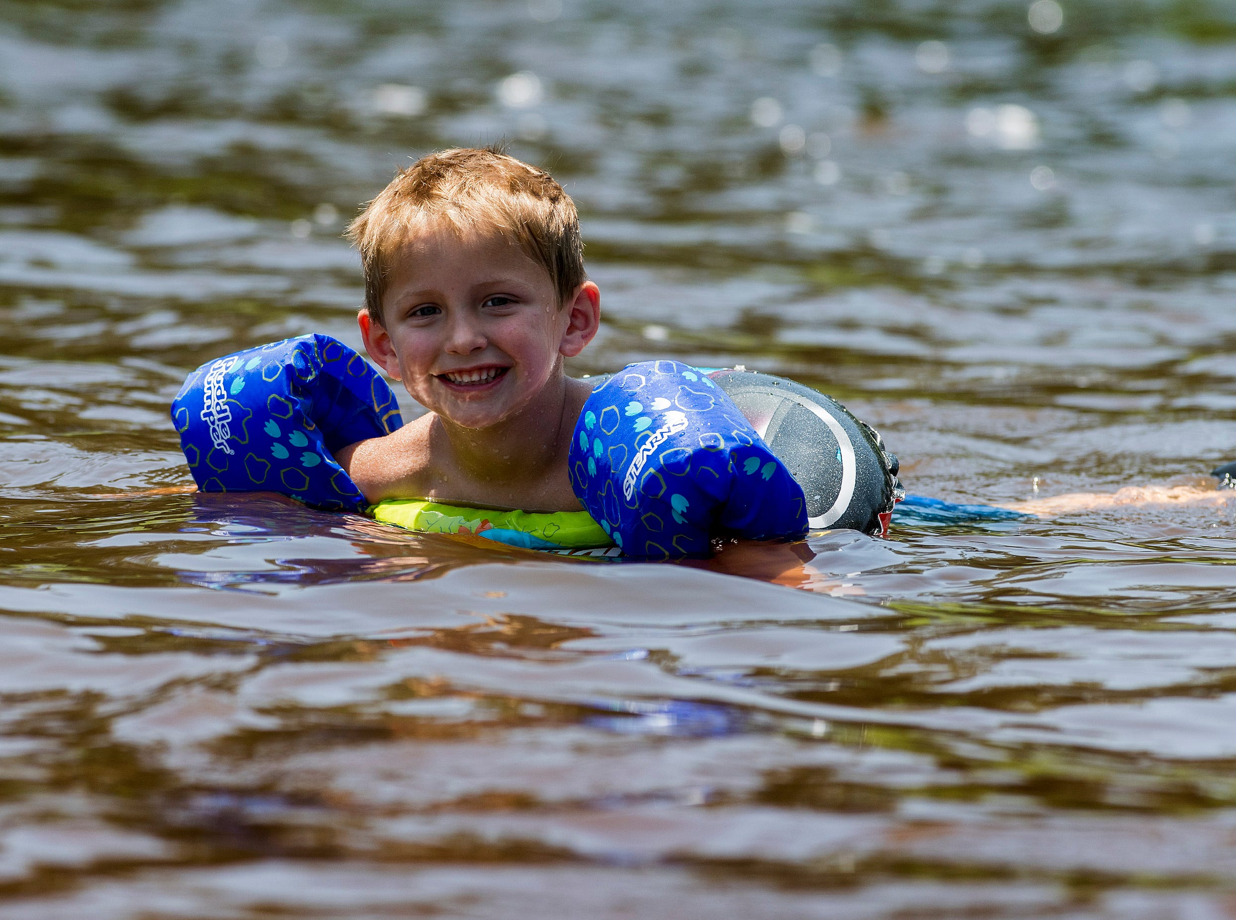 Sawyer Sims floats in Autauga Creek in Prattville, Ala., on Saturday, July 21, 2018.