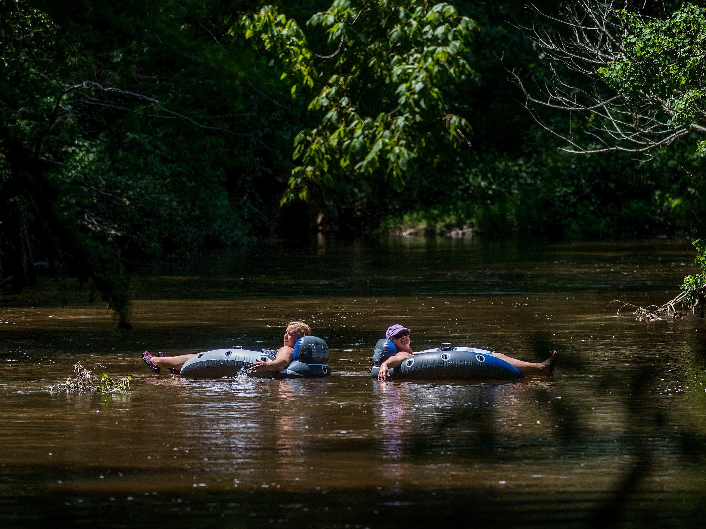 Shannon Eady and Karson Smith float on Autauga Creek in Prattville, Ala., on Saturday, July 21, 2018.