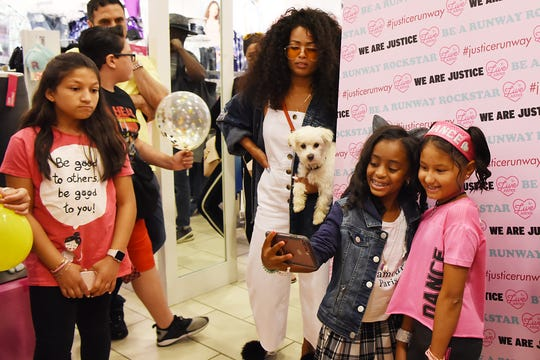 Heaven King and Kylie Torres, take a selfie after the  fashion show at Justice in the Wiilowbrook Mall in Wayne on Saturday July 21, 2018.