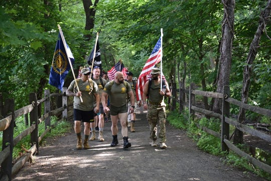 The Woodland Park American Legion members took on a 5K march on Saturday to visit the elderly veterans who are unable to make it to the post themselves.