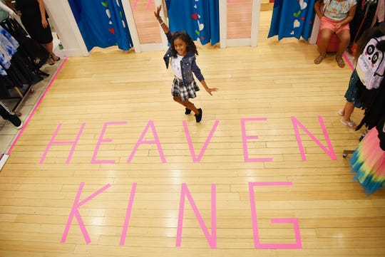 Heaven King, poses for a photo near her name after the fashion show at Justice in the Wiilowbrook Mall in Wayne on Saturday July 21, 2018.