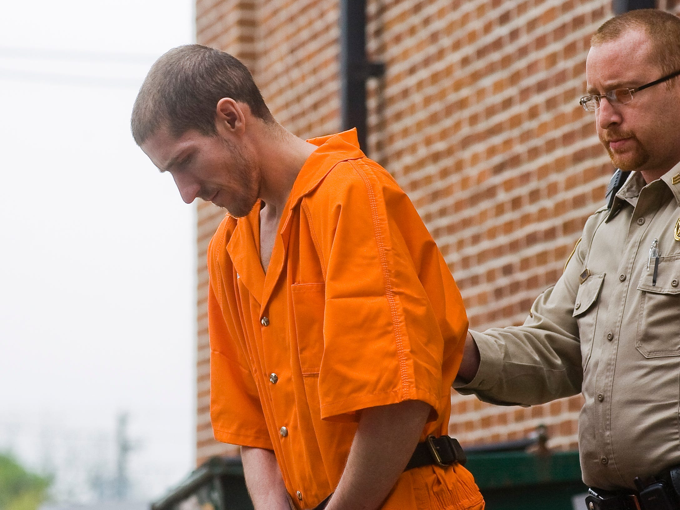 An Adams County Sheriff deputy leads Jonathan Leonard, 25, out of the Adams County Courthouse on April 18, 2012 after his preliminary hearing. Leonard faces charges of criminal homicide, robbery and theft, and also added on Wednesday was a charge of involuntary deviate sexual intercourse.