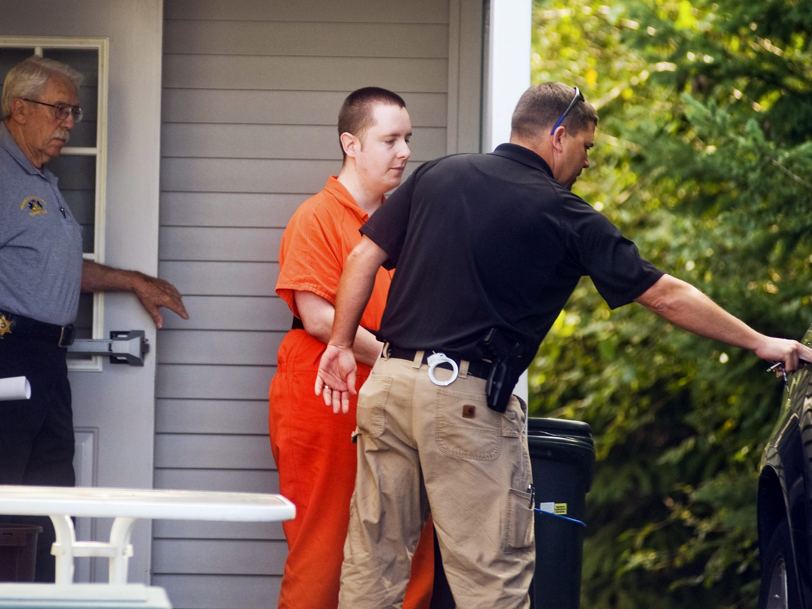 Scott Anthony Schaffer is escorted to a waiting vehicle after Tuesday's hearing at the office of Judge Dwayne Dubs on September 3, 2013.