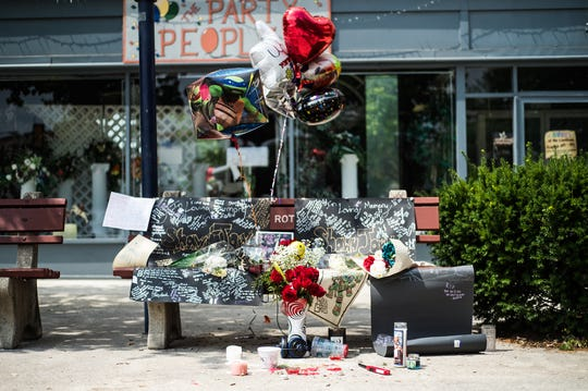 Flowers and messages for Shawn Jarvis are left on a bench in Hanover's Center Square on June 29, 2014.