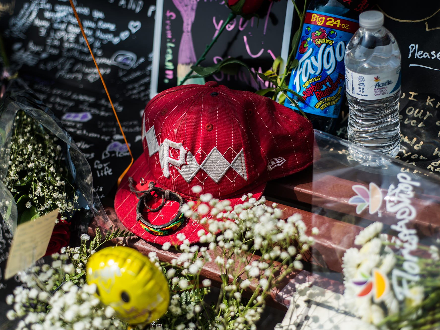 A Pittsburgh Pirates cap sits among the flowers, messages and other gifts left for Shawn Jarvis, a Hanover man who was killed the night of June 27, 2014 in the town's Center Square.