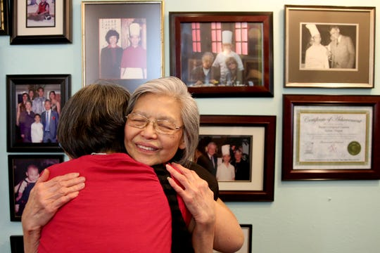 Bo Kwan, facing, the wife of Kam Sang Kwan, hugs Julie Yip, 63, of Salem, during a celebration of life honoring Kam Sang Kwan at Kwan's Original Cuisine in Salem on Saturday, July 21, 2018. The beloved Salem chef died June 17 at 82 years old.