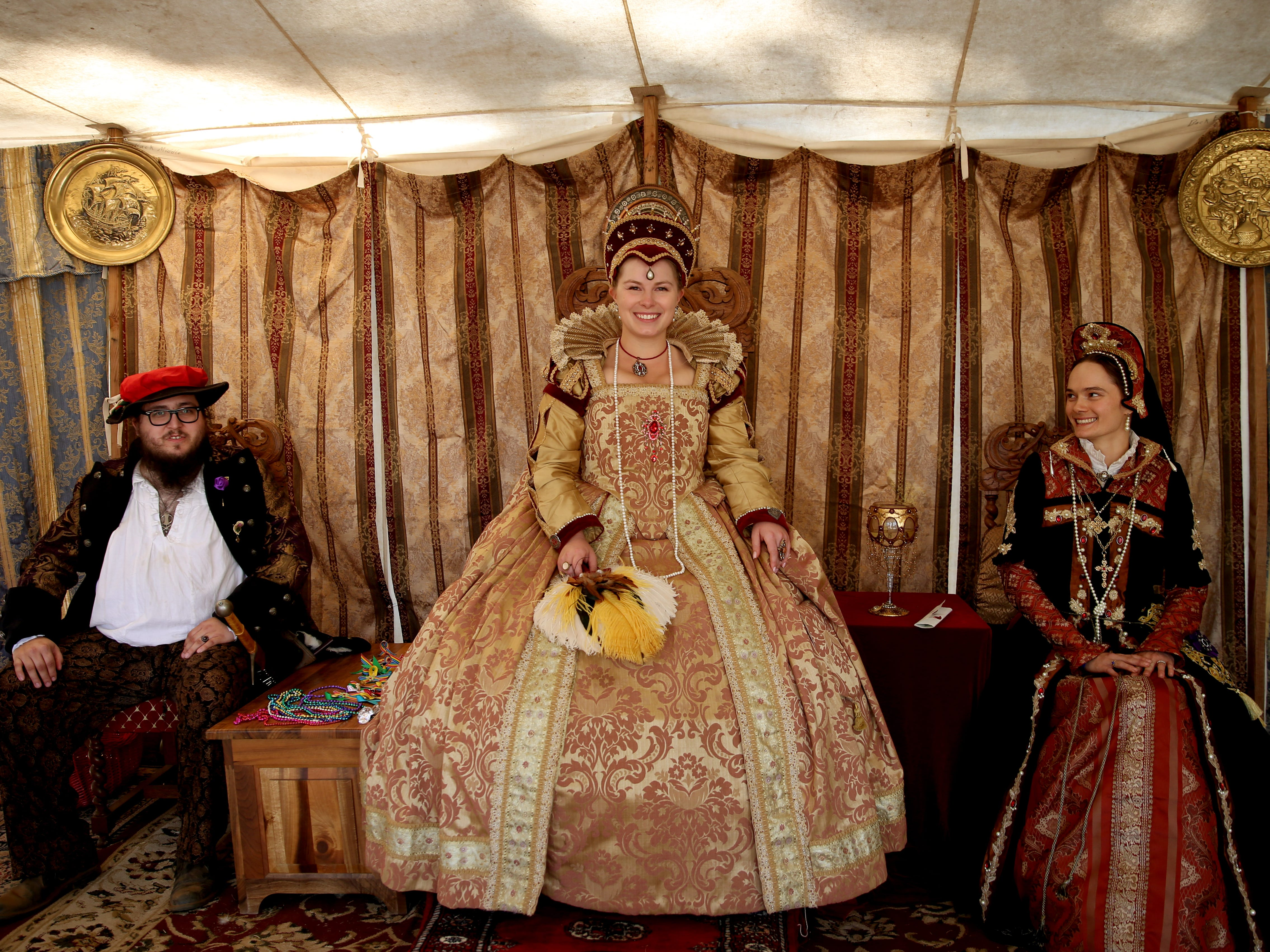 Alison White, of Wilsonville, as Queen Elizabeth I, with her court during the Canterbury Renaissance Faire near Silverton on Saturday, July 21, 2018. The faire continues July 22, 28 and 29.