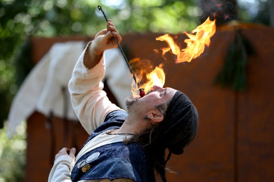 Gavin DeMersseman performs eating fire as Gavin the Crossroads Mystic during the Canterbury Renaissance Faire near Silverton on July 21, 2018.