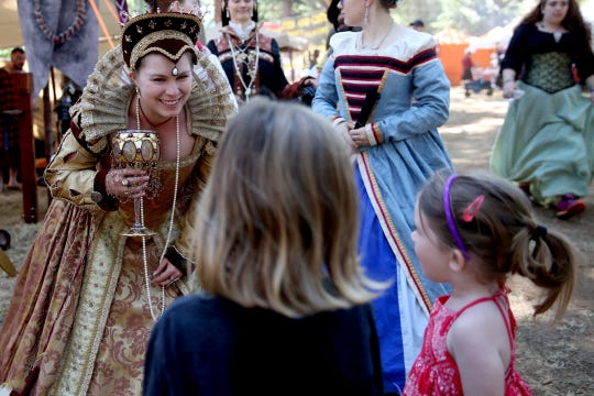 Alison White, of Wilsonville, as Queen Elizabeth I, speaks with sisters Ariel, 5, and Hollie Mee, 3, of Salem, during the Canterbury Renaissance Faire near Silverton on Saturday, July 21, 2018. The faire continues July 22, 28 and 29.