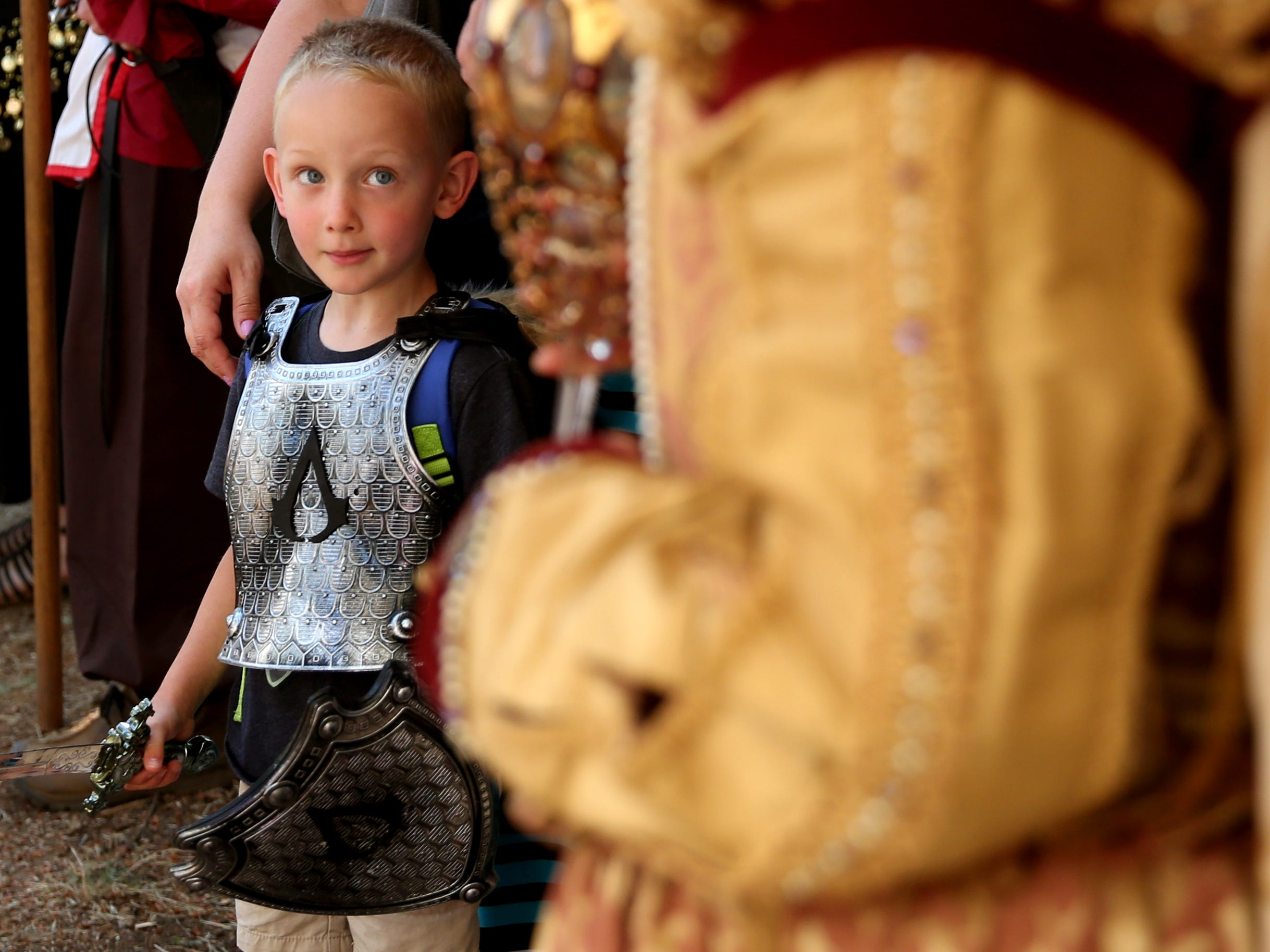 Cooper Redding, 5, of Oregon City, watches Alison White, of Wilsonville, as Queen Elizabeth I, during the Canterbury Renaissance Faire near Silverton on Saturday, July 21, 2018. The faire continues July 22, 28 and 29.
