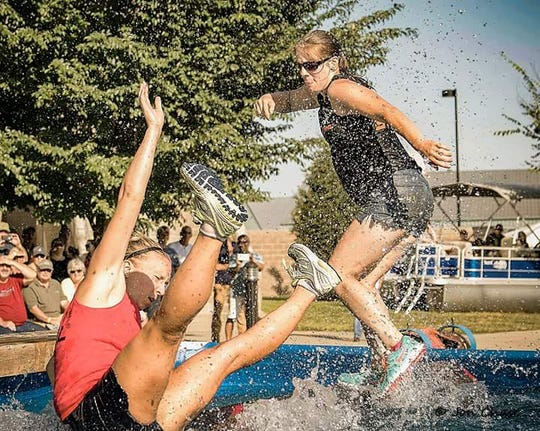 Visitors splash in a water attraction at the Ozark Empire Fair.