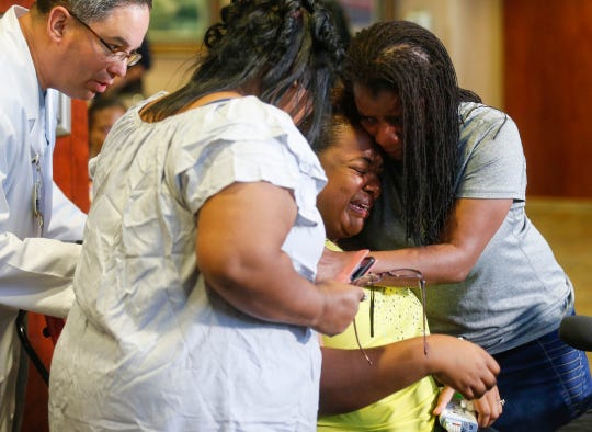 Tia Coleman, center, a survivor of the Ride the Ducks incident on Table Rock Lake on July 19, 2018, is comforted by her sisters Leeta Bigbee, right, and Yelena Brackney following a press conference at Cox Medical Center Branson on July 21, 2018. Coleman lost 9 family members in the tragedy.