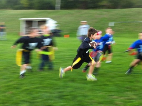 Co-ed flag football is offered at the YMCA for kids age 5-12.