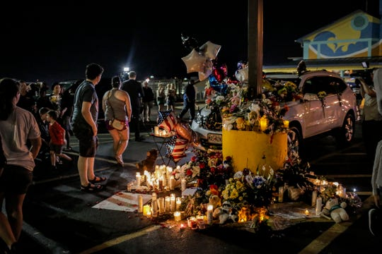 300 community members gathered in the parking lot outside Ride the Ducks, lighting candles and placing flowers on the cars of two victims from the duck boat accident in Branson, Mo. on Friday, July 20, 2018. On Thursday, July 19, 2018 17 people were killed when a duck boat, an amphibious vehicle, capsized on Table Rock Lake.