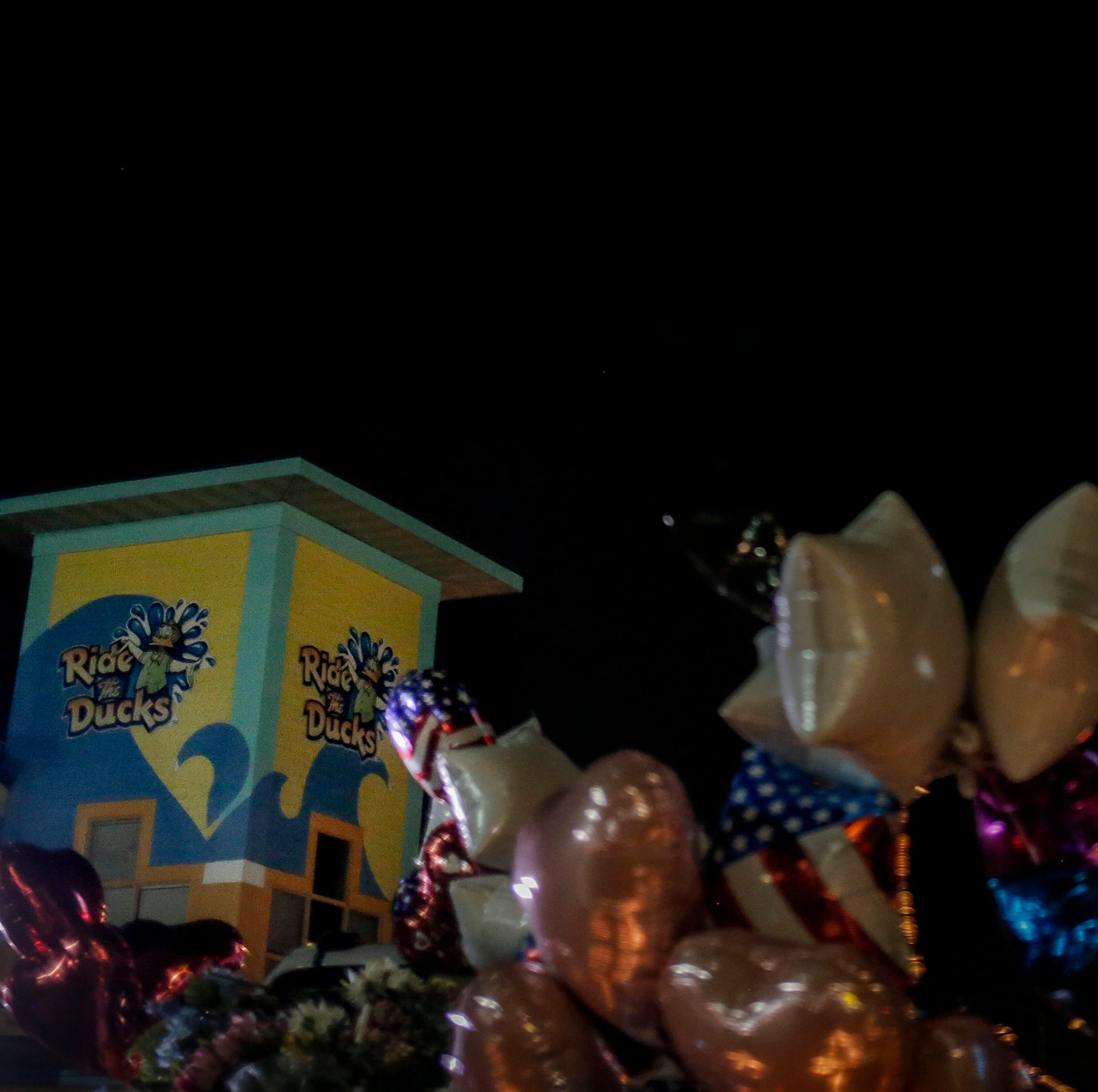 300 community members gathered in the parking lot outside Ride the Ducks, lighting candles and placing flowers on the cars of two victims from the duck boat accident in Branson, Mo. on Friday, July 20, 2018. On Thursday, July 19, 2018, 17 people were killed when a duck boat, an amphibious vehicle, capsized on Table Rock Lake.
