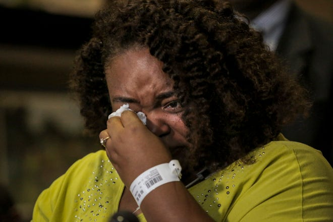 Tia Coleman, a survivor of the Ride the Ducks duck boat accident that left 17 dead on Thursday, wipes away her tears while speaking to members of the media about her experience during a press conference at the Cox Medical Center Branson on Saturday, July 21, 2018 in Branson, Mo. Coleman lost 9 family member in the tragedy.