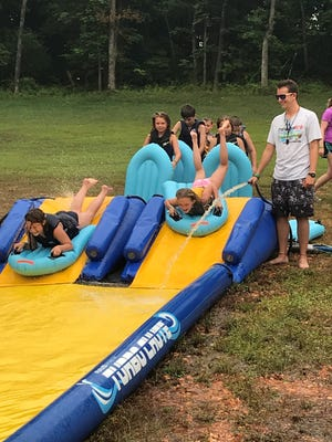 New this year at the YMCA's Camp Wakonda is a 120-foot Slip-and-Slide that ends with campers going into the lake.